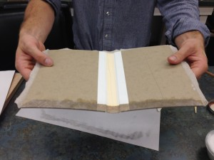 Here is Brien showing off his experiment using the airplane linen as the exterior book cloth. We both thought it turned out very nice es
