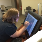 DTP student Jackie Palmer digitizing the contour lines on the topographic map.